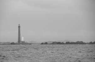 Phare de la Vierge on the rocks jpg